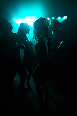 Young people clubbing (back lighting) - p5140418f by Clover photography