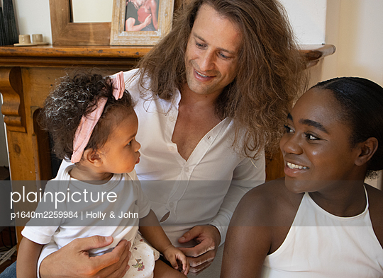 Multi ethnic family with toddler girl - p1640m2259984 by Holly & John