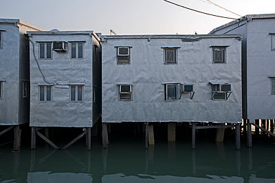 House on stilts in the village of Tai O on Lantau Island - p589m1171125 by Thierry Beauvir