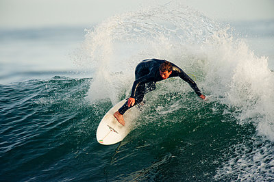 Surfing Campus Point in Santa Barbara, California. - p343m1202387 by Kevin Steele