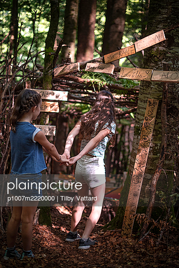 Two girls playing in a hut in the forest - p1007m2220000 by Tilby Vattard