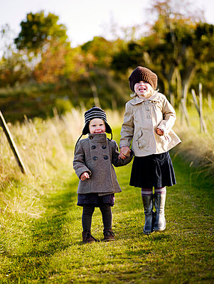 Girls walking on field in autumn - p5282719 by Anna Kern