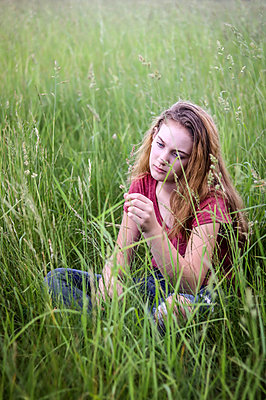 Girl in Grass - p1019m1441876 by Stephen Carroll