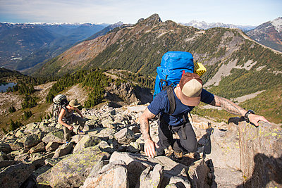 Two men hike up a a rocky slope toward Douglas Peak, British Columbia. - p1166m2095126 by Cavan Images
