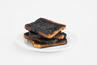 Burnt toast on plate - p30016357f by Gaby Wojciech