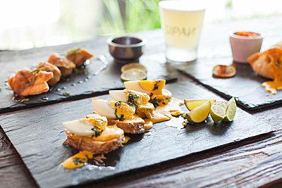 Appetizers on plate - p623m1495173 by Gabriel Sanchez