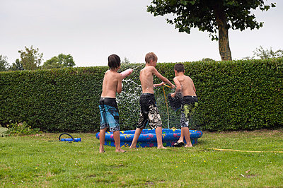 Children by wading pool - p896m834554 by Sabine Joosten