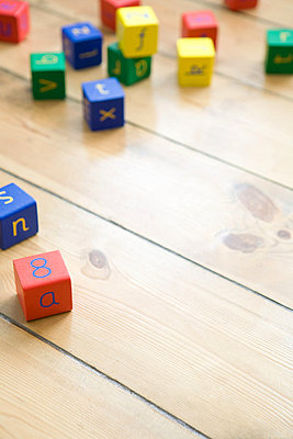 Building blocks on wooden floor - p9244745f by Image Source