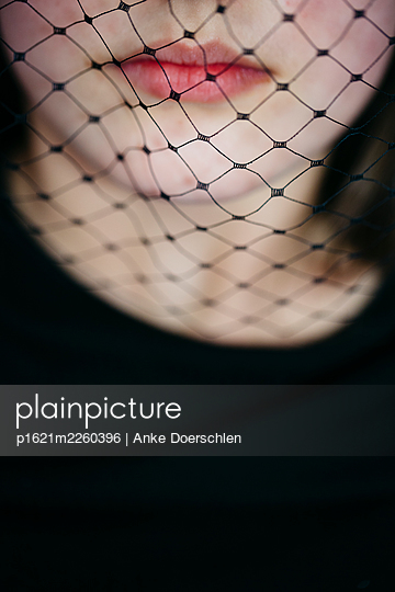 Young girl with a black veil - p1621m2260396 by Anke Doerschlen