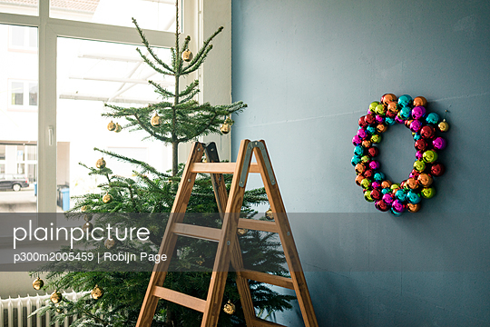 Christmas tree, Christmas wreath and ladder in a loft