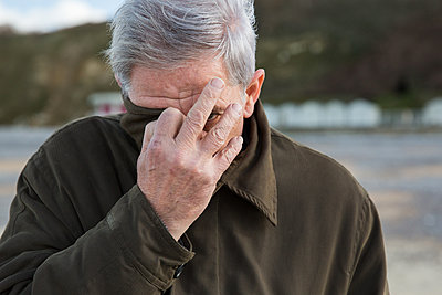 Image result for older man hiding his face