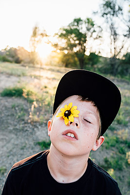 Boy with Sunflower as an eye - p1262m1444506 by Maryanne Gobble