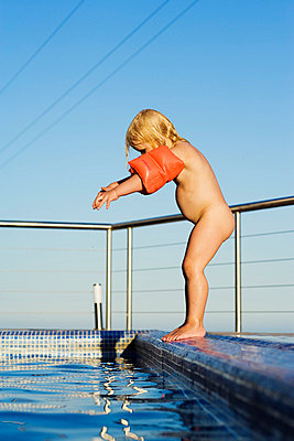 A little Scandinavian girl by a swimming pool. - p31221193f by Ingemar Lindewall