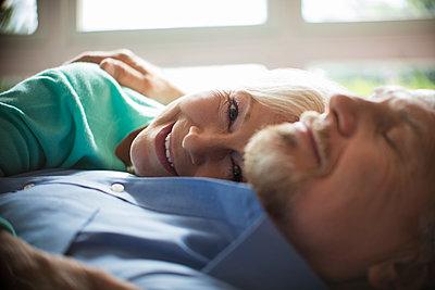 Close up portrait happy carefree senior couple cuddling - p1023m2213045 by Tom Merton
