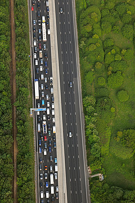 Motorway Traffic jam one side - empty the other - p1048m1135513 by Mark Wagner