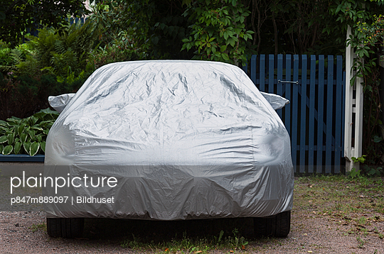 Car Covered By Silver Protective Sheet - p847m889097 by Bildhuset