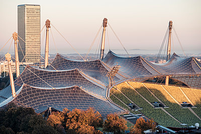 Germany, Munich, Olympic Park, Olympic Stadium, tent roof construction in the morning light - p300m2104502 by Wilfried Feder