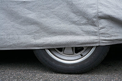 Covered car tire - p3881508 by Bill Davies