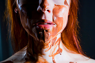 Woman coverd with hocolate - p4130458 by Tuomas Marttila