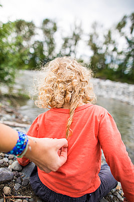 Woman holding curly hair of baby boy - p1166m2201991 by Christopher Kimmel / Alpine Edge Photography