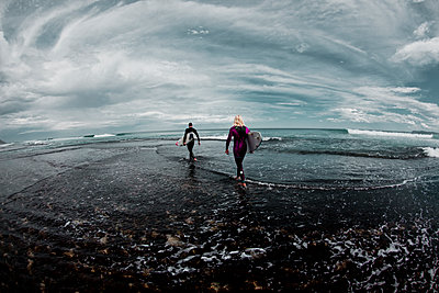 Surfer on beach - p416m1056943 by Andy Fox