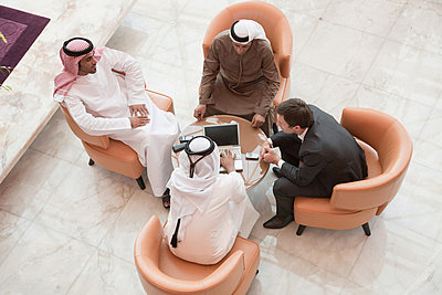 High angle view of businessmen having a meeting - p9244779f by Image Source