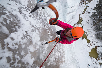 High angle view of female hiker ice climbing - p1166m1521817 by Cavan Images