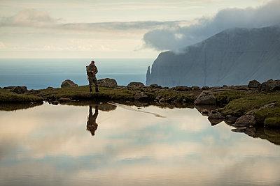 Man fishing in lake - p312m2051454 by Hans Berggren