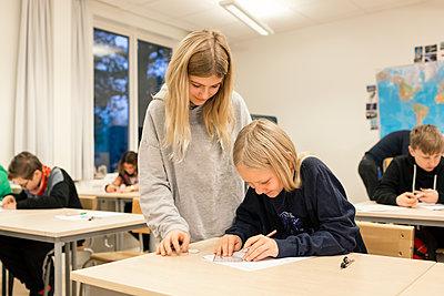 Girls in classroom - p312m2174784 by Scandinav