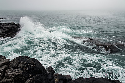 Waves crashing into rocky shore - p354m1043352 by Andreas Süss