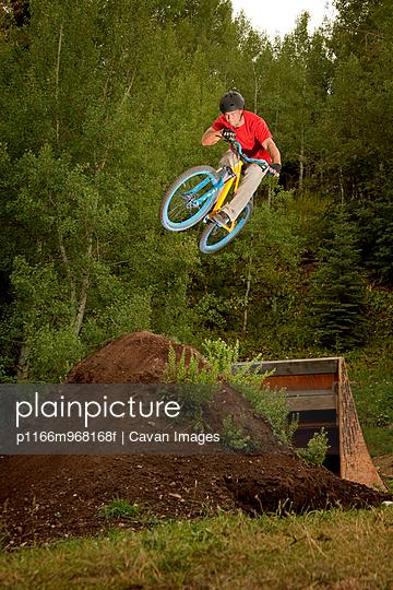 BMX Biker Jumping Off Ramp
