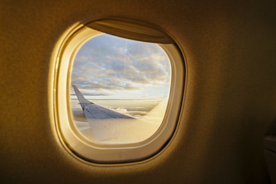 View out of window on wing of a plane - p300m2042234 by Kike Arnaiz