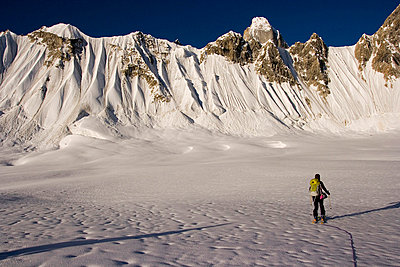 A woman ski mountaineering on the Biafo glacier in the Karakoram Himalaya of Pakistan - p3433812 by Bill Stevenson