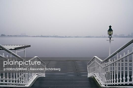 Jetty on the Alster river in the fog, Hamburg - p1696m2296646 by Alexander Schönberg