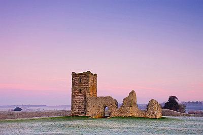 Ruins of Knowlton Church beneath pastel pink skies on a frosty winter morning, Knowlton, Dorset, England, United Kingdom, Europe - p8713099 by Adam Burton