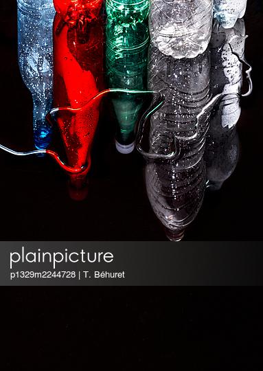 Plastic bottles reflection - p1329m2244728 by T. Béhuret