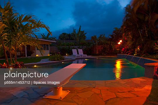 Tropical Backyard Pool at Night