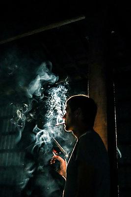 Smoking man with pistol - p1019m2122108 by Stephen Carroll