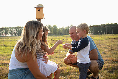 Young family on rural farm - p1192m2047605 by Hero Images