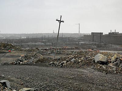 Electricity pylon on a road nearby a mine - p1216m2187282 by Céleste Manet