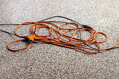 Extension cord on a floor - p1614m2211821 by James Godman