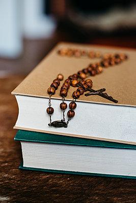 Prayer beads on books - p1621m2278158 by Anke Doerschlen