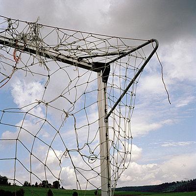 Corner of goal post and broken net - p3015540f by Ragnar Schmuck