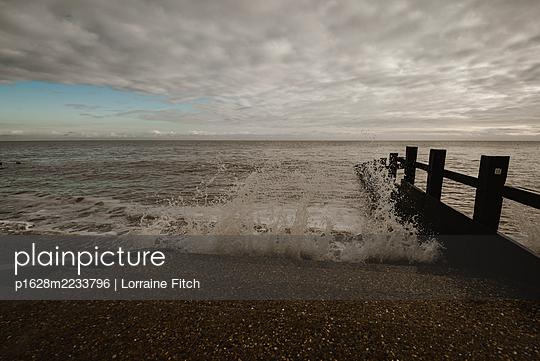 Winter Sunday on the beach - p1628m2233796 by Lorraine Fitch