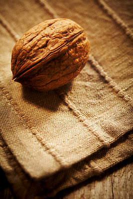 Walnuts on a wooden table - p968m658859 by Roberto Pastrovicchio