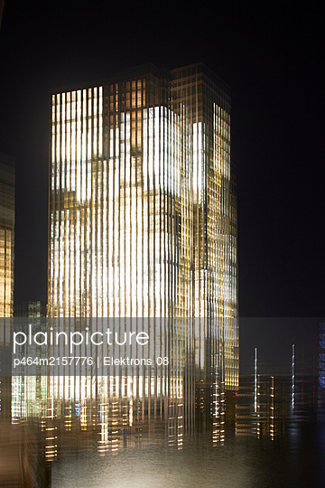 Illuminated office buildings - p464m2157776 by Elektrons 08