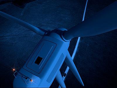 Wind turbine at night - p1275m1423862 by cgimanufaktur
