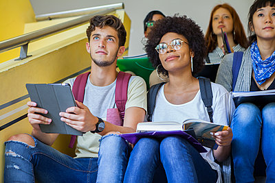 Group of college students studying on stairs - p623m1579580 by Dinoco Greco
