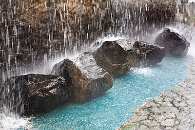 Rocks under waterfall - p4426475f by Design Pics
