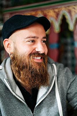Portrait of bearded man in a tea shop - p300m2180102 by Daniel González